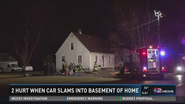 2 Hurt When Car Slams Into Basement Of Home